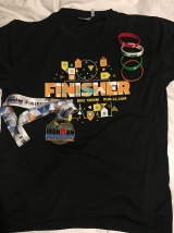 The finisher's shirt (minus the swim), the medal and my run lap bands!